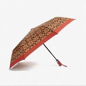 Coach umbrella with peony flower print